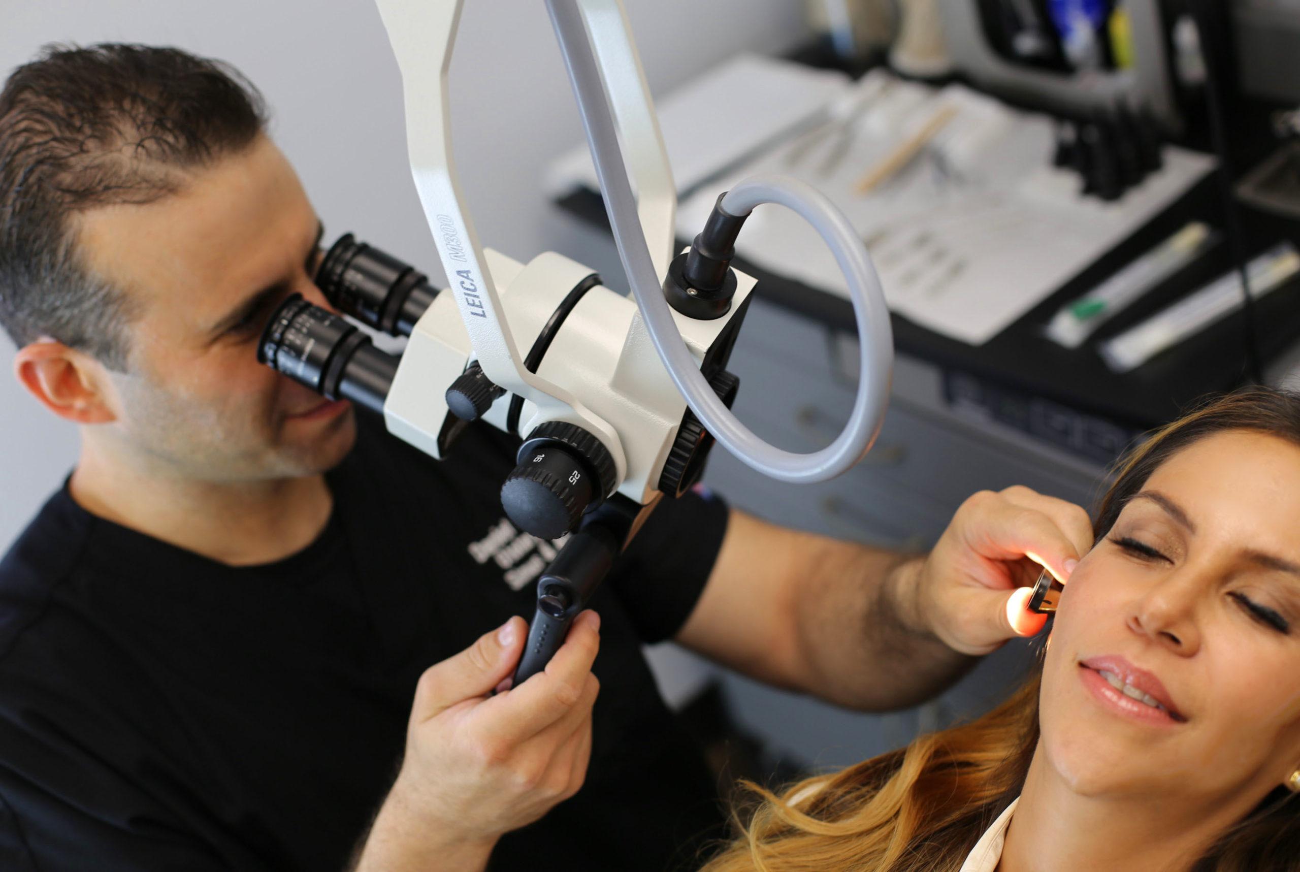 Dr. Daniel Ganc examining a patient