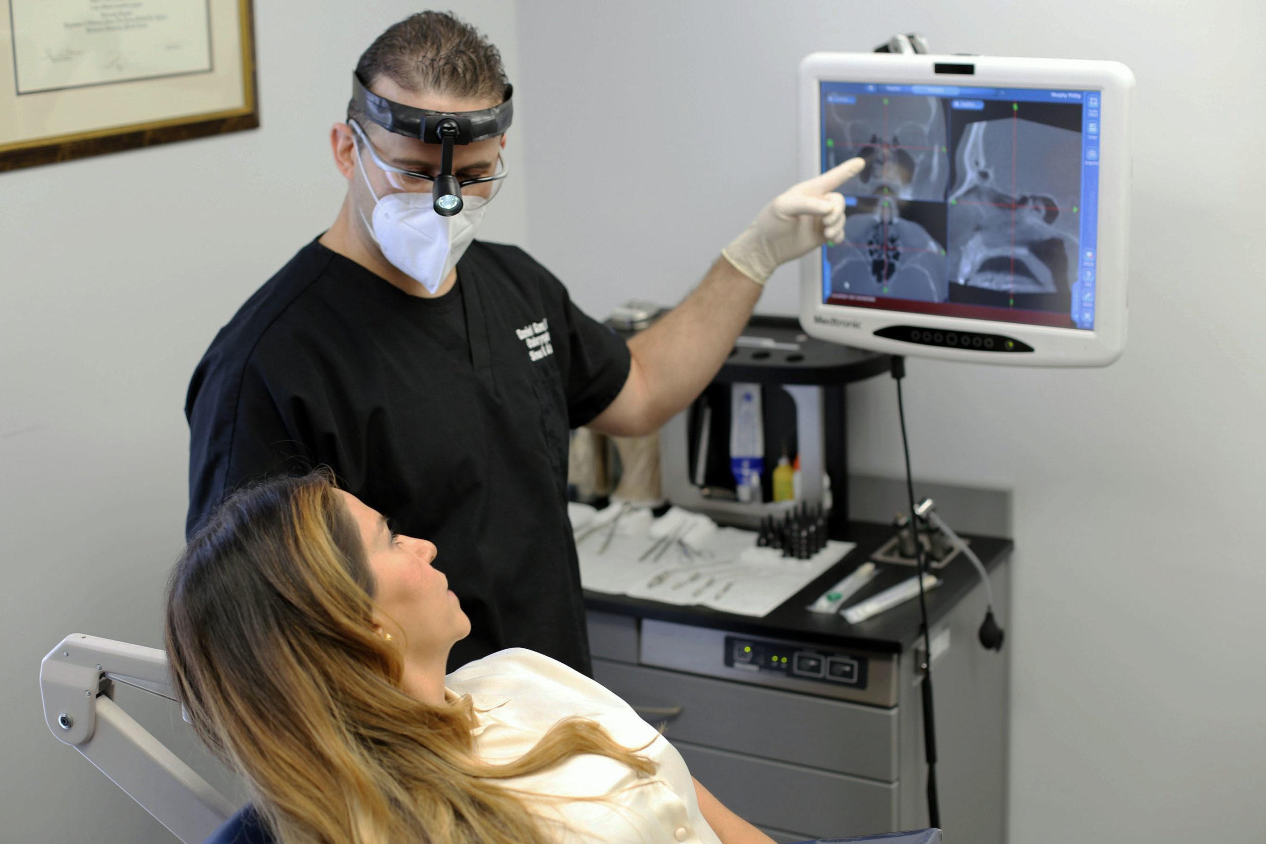 Dr. Daniel Ganc viewing CT sinus